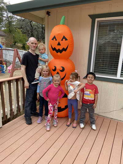 The holiday season includes posing with an inflatable pumpkin